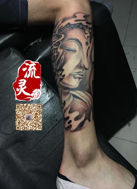 小腿外侧佛头纹身